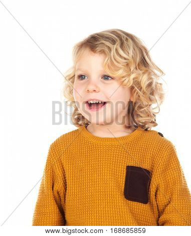 Happy small blond child with yellow jersey isolated on a white background