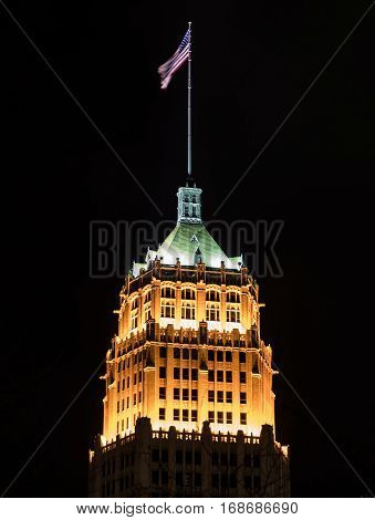 San Antonio United States: January 21st 2017: Flag flies above the Tower Life Building in San Antonio at night