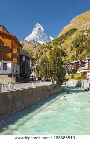 ZERMATT, SWITZERLAND - September 02: Hotel Perren with views of the Matterhorn in central Zermatt and river Matter Vispa, Switzerland on September 02, 2016