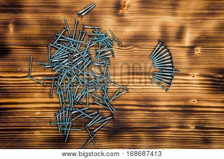 Wooden Screws On Burnt Wooden Desk
