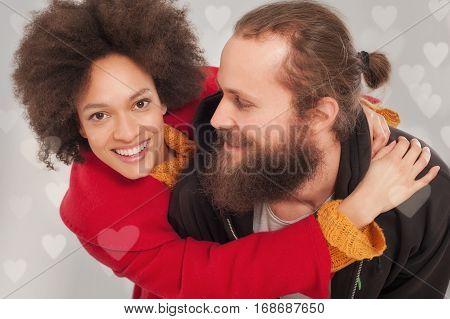 Romantic Multiethnic Couple In Love Hugging On The Studio