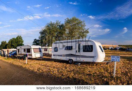car caravan trailer in camp - blue sky background