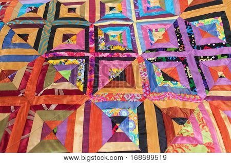 Multi Color Patchwork quilt. Part of patchwork quilt as background. Handmade.