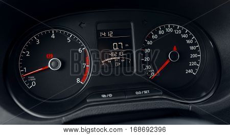Modern car dashboard display close up. analog  odometer and speedometer