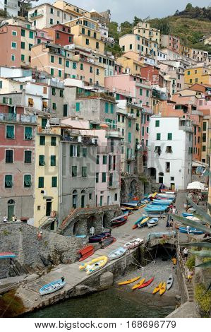 Riomaggiore the most southern village of the five Cinque Terre in Italy all connected by rail. The water and mountainside have been declared national parks.