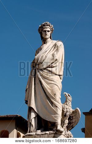 The statue of the famous poet Dante Alighieri on Piazza Santa Croce in Florence Italy.