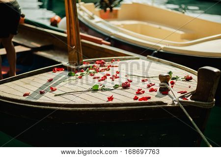 roses on boat. Romantic boat sailing. Romantic boat