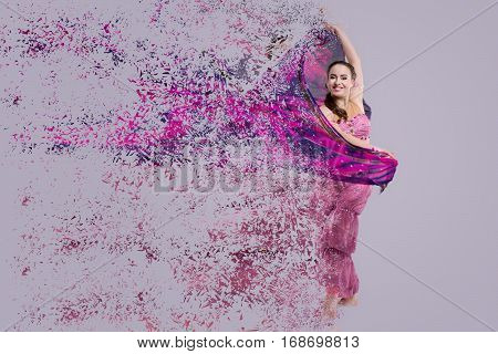 Dancer with disintegrating scarf. Abstract vision.Photo manipulation