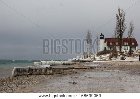 Ice covered beach of Point Betsie Light in Michigan