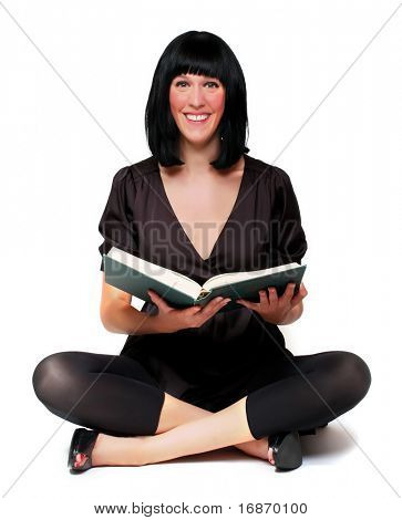 Portrait of a attractive girl with opened book.