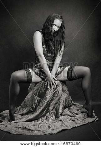 Low key lighting studio monochrome shot young beautiful women in black lingerie. Great image for calendar.