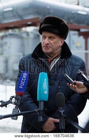 ST. PETERSBURG, RUSSIA - DECEMBER 16, 2016: Chief engineer of TEK SPb Ivan Repin talk with press at the boiler plant Parnas. It is the largest heat energy source in Northern Europe
