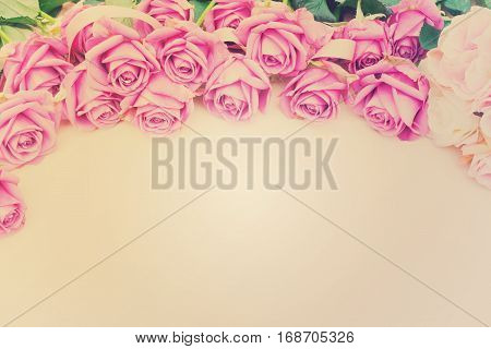 Valentines day violet roses top view flat ly border with copy space, retro toned