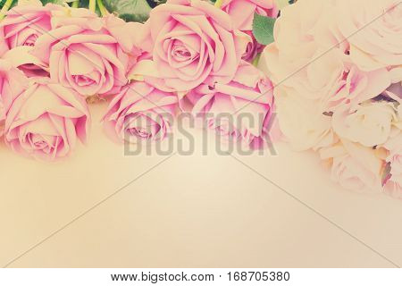 Valentines day violet and pink roses top view flat ly border, retro toned