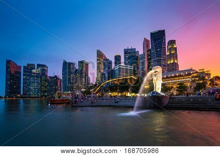 Singapore - June 25, 2016: Singapore skyline, Marina bay and Merlion fountain view at dusk