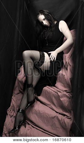 Low key lighting studio shot young beautiful women on pink background. Great image for calendar.