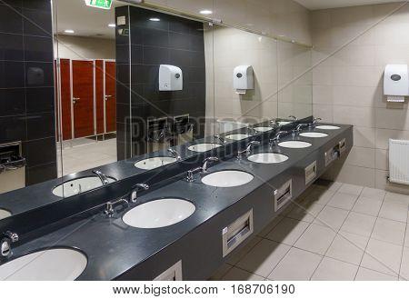 Public modern wc men's room interior