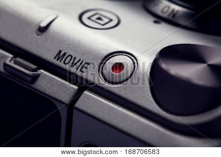 movie play button on the body of modern audio-video devices