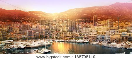 Monte Carlo marine with yachts and sail boats and town view at sunset. Monaco