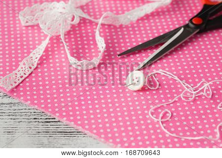 Needle And Button On Pink Polka Dot Cloth