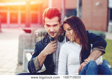 Young couple on first date outdoor in sunset