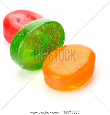 Three colorful fruit hard sugar candies,  boiled sweeties or sugar plums isolated on white background cutout.