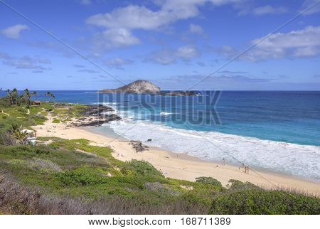 MAKAPU'U BEACH OAHU HAWAII - JANUARY 27 2017: Makapu'u Beach on Oahu's southeast coast is a fantastic getaway with good surf in turquoise blue water and beautiful views of nearby islands.