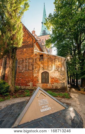 Riga, Latvia - July 01, 2016: Pyramidal Monument To Barricades And Perished People On January 20 1991 On Jekaba Street. Political Confrontations Between Latvian And Soviet Forces. St. James Cathedral Behind.