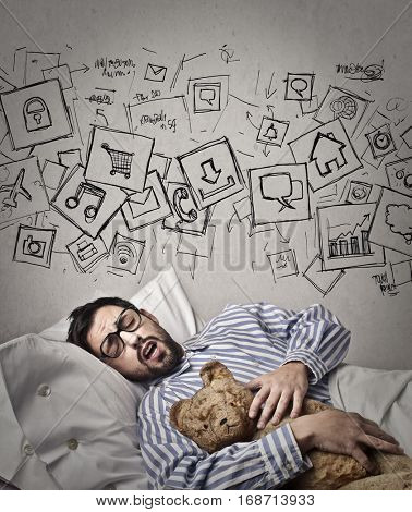 Man with teddy bear having lots of toughts while sleeping