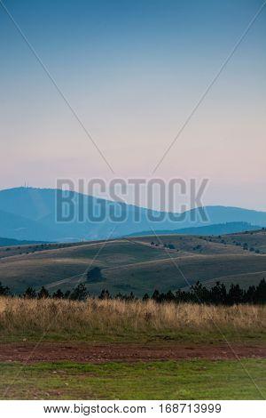 hilly nature landscape at dusk background