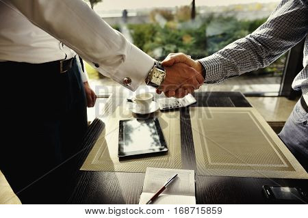 Two Business Man Sitting At Table Cafe Closeup Coffee Break Meeting Businessman Hand Shake Agreement