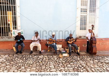 Trinidad, Cuba 2016.01.30 Traditional musicians playing in the streets of Trinidad. Trinidad declared by UNESCO World Heritage Site in 1988.
