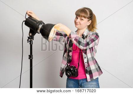 Photographer Studio Sets Reflector On Monoblock Flash