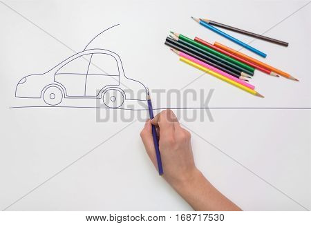 Hand painted car on the road with colored pencils