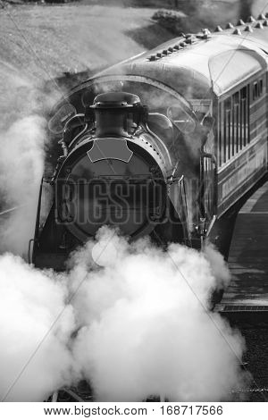 Restored Victorian Era Steam Train Engine With Full Steam In Black And White