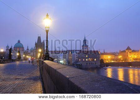 Prague, Czechia - November, 21, 2016: Charles Bridge in Prague, Czechia early in the morning