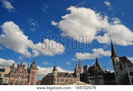 Antwerpen, Belgium - May 24, 2014. The skies in Antwerp, with upper sections of historic buildings and clouds, from the promenade of Scheldt Riverbank.