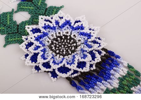 Decoration of beads; flower on a light background