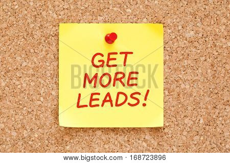 Get More Leads handwritten on yellow sticky note pinned on cork bulletin board.