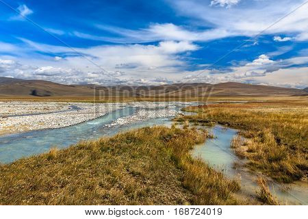 Beautiful landscape with mountains, river and blue sky. Plateau Ukok, Altai