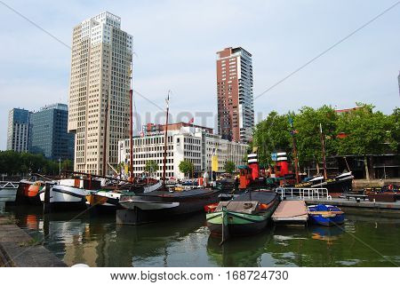 Rotterdam, The Netherlands - July 27, 2014. View of Wijnhaven wharf in Rotterdam, with boats and modern buildings in the background.