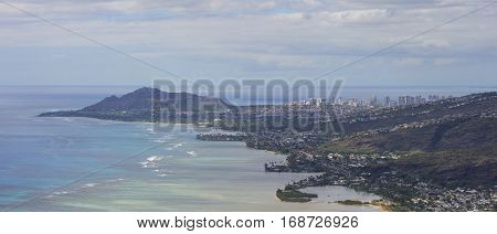 Panoramic of Waialae Diamond Head Waikiki and Honolulu with surf along off shore reef seen from Koko Crater on Oahu