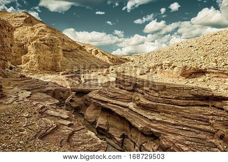The Red Canyon tourist and geological attraction in Israel. (HDR image with black gold filter)