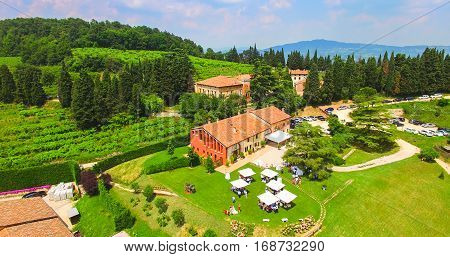 Soave, Italy - June 6, 2016: Aerial view of an old farmhouse in the hills around Soave Italy.