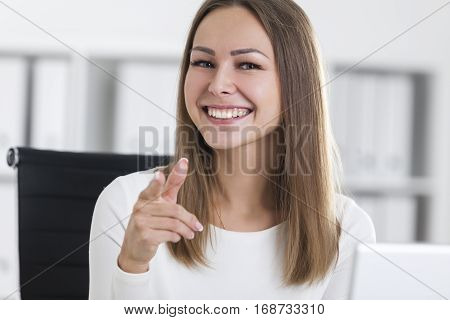 Close Up Of A Girl In White Pointing At You