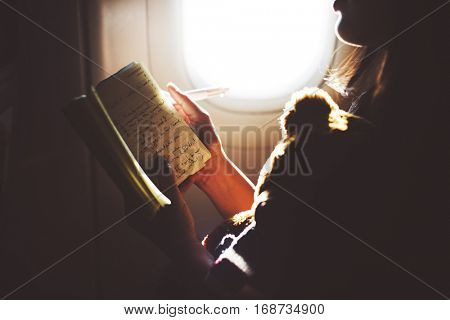 Woman Reading Book Plane Flying Concept