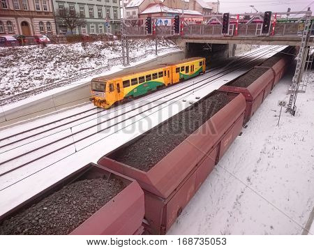 PILSEN CZECH REPUBLIC - JANUARY 11, 2017: Cargo train wagons loaded lignite for powerplant in winter season. Transportation, power and fuel generation industry in European Union.