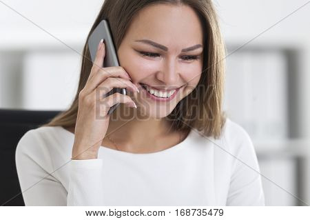 Front View Of Smiling Woman With A Smartphone
