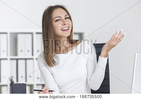 Happy Blond Woman In A White Office