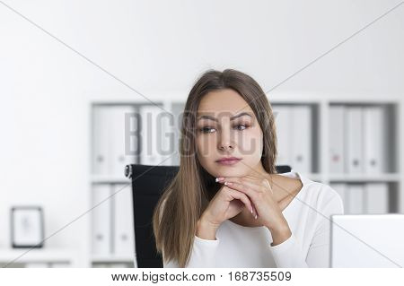 Portrait Of Pensive Blond Woman In White In Office